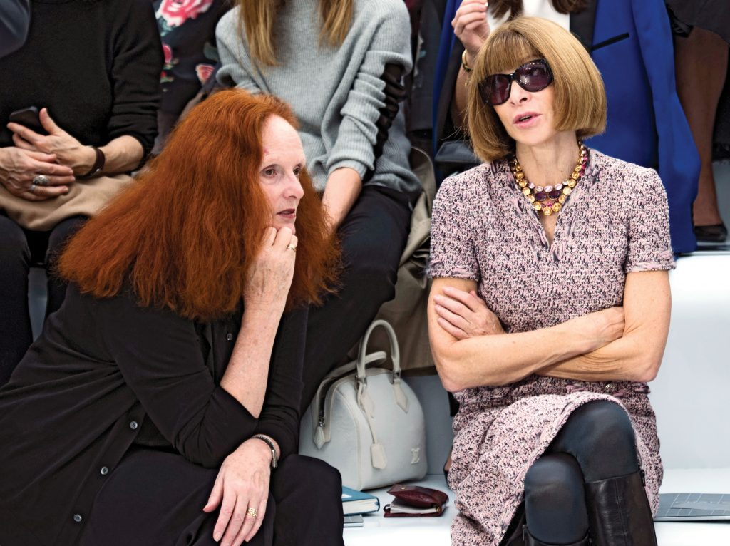 US Vogue's artistic director Grace Coddington (L) and US Vogue editor in chief Anna Wintour chat prior to the Chanel Spring/Summer 2013 ready-to-wear collection show on October 2, 2012 at the Grand Palais in Paris. AFP PHOTO/MARTIN BUREAU (Photo credit should read MARTIN BUREAU/AFP/GettyImages)