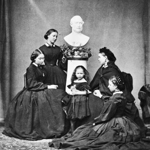 Queen Victoria's five daughters in mourning, next to a bust of their father, 1862